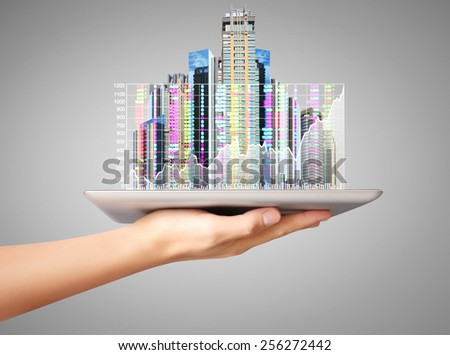 man hand using tablet computer, looking real estate - stock photo