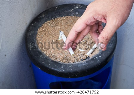 Man hand with cigarettes. Selective focus concept. Stop smoking  - stock photo