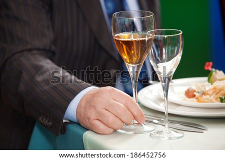 Man hand with glass, close up - stock photo