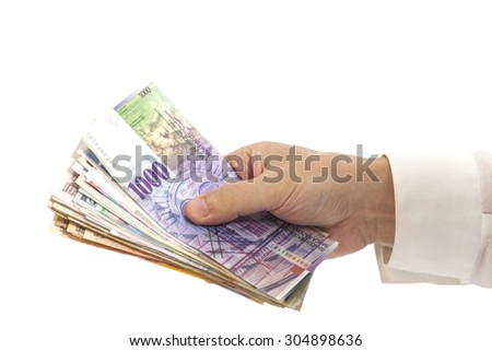 Man Hand With International Currencies isolated - stock photo