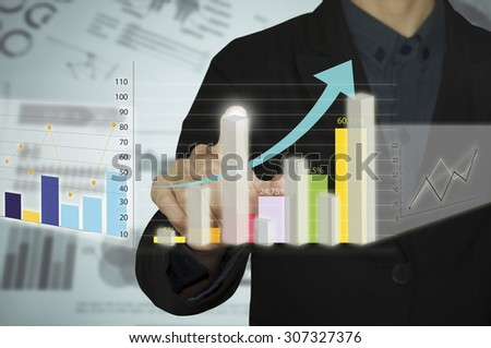 Man hand with pen drawing a graph chart and business strategy as concept on whiteboard - stock photo