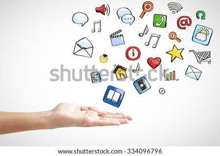 Man hand with social media icons concept  - stock photo