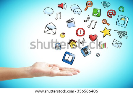 Man hand with social media icons concept