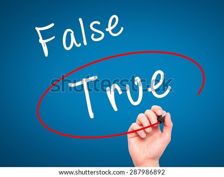 Man Hand writing an choosing True instead of False with black marker on visual screen. Isolated on blue. Business, technology, internet concept. Stock Image - stock photo