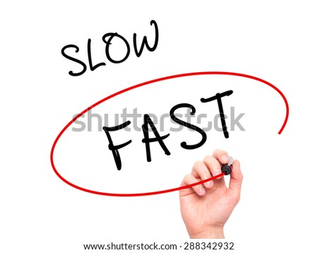 Man Hand writing and Choosing Fast instead of Slow with black marker on visual screen. Isolated on white. Business, technology, internet concept. Stock Image - stock photo