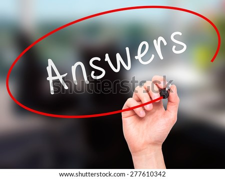 Man Hand writing Answers with marker on transparent wipe board. Isolated on office. Business, internet, technology concept.  Stock Photo - stock photo