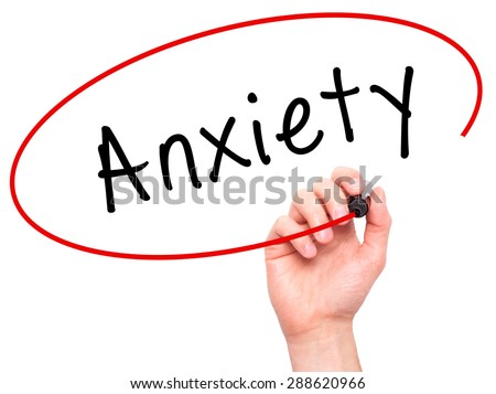 Man Hand writing Anxiety with black marker on visual screen. Isolated on white. Business, technology, internet concept. Stock Image - stock photo