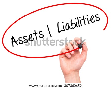 Man Hand writing Assets Liabilities with black marker on visual screen. Isolated on white. Business, technology, internet concept. Stock Photo - stock photo