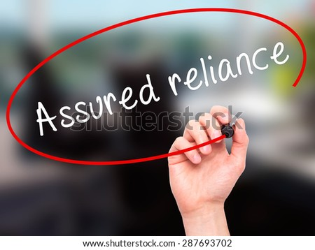 Man Hand writing Assured reliance with black marker on visual screen. Isolated on office. Business, technology, internet concept. Stock Image - stock photo