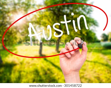 Man Hand writing Austin  with black marker on visual screen. Isolated on nature. Business, technology, internet concept. Stock Photo - stock photo