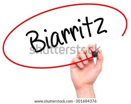 Man Hand writing Biarritz  with black marker on visual screen. Isolated on white. Business, technology, internet concept. Stock Photo - stock photo