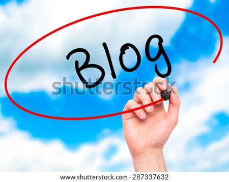 Man Hand writing Blog with marker on transparent wipe board. Isolated on sky. Business, internet, technology concept. Stock Photo - stock photo