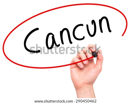 Man Hand writing Cancun with black marker on visual screen. Isolated on white. Travel, technology, internet concept. Stock Image - stock photo