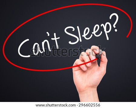 Man Hand writing Cant Sleep? with black marker on visual screen. Isolated on black. Business, technology, internet concept. Stock Photo - stock photo