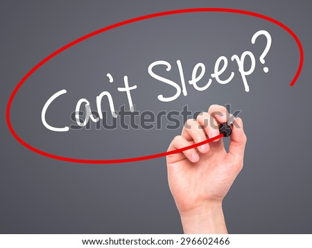 Man Hand writing Cant Sleep? with black marker on visual screen. Isolated on grey. Business, technology, internet concept. Stock Photo - stock photo