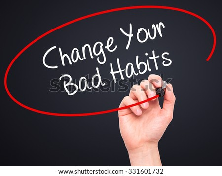 Man Hand writing Change Your Bad Habits  with black marker on visual screen. Isolated on black. Business, technology, internet concept. Stock Photo - stock photo