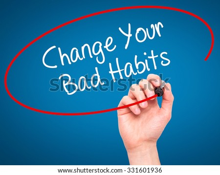 Man Hand writing Change Your Bad Habits  with black marker on visual screen. Isolated on blue. Business, technology, internet concept. Stock Photo - stock photo