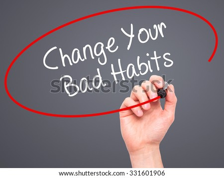 Man Hand writing Change Your Bad Habits  with black marker on visual screen. Isolated on grey. Business, technology, internet concept. Stock Photo - stock photo