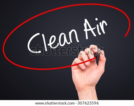 Man Hand writing Clean Air with black marker on visual screen. Isolated on black. Business, technology, internet concept. Stock Photo - stock photo