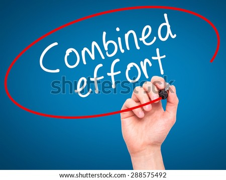 Man Hand writing Combined effort with black marker on visual screen. Isolated on blue. Business, technology, internet concept. Stock Image - stock photo