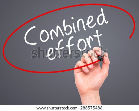 Man Hand writing Combined effort with black marker on visual screen. Isolated on grey. Business, technology, internet concept. Stock Image - stock photo