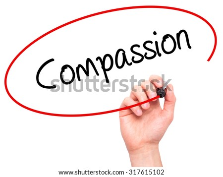 Man Hand writing Compassion with black marker on visual screen. Isolated on white. Business, technology, internet concept. - stock photo