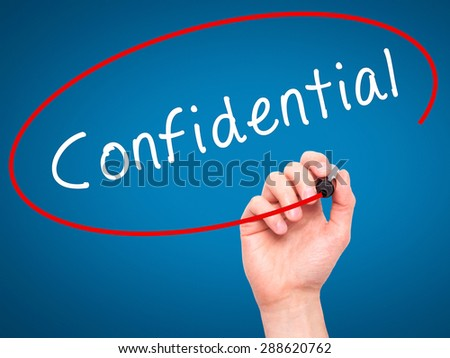 Man Hand writing Confidential with black marker on visual screen. Isolated on blue. Business, technology, internet concept. Stock Image - stock photo
