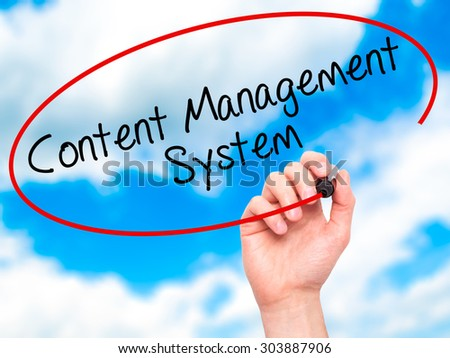 Man Hand writing Content Management System  with black marker on visual screen. Isolated on sky. Business, technology, internet concept. Stock Photo - stock photo