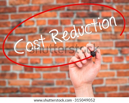 Man Hand writing Cost Reduction with black marker on visual screen. Isolated on bricks. Business, technology, internet concept. Stock Photo - stock photo