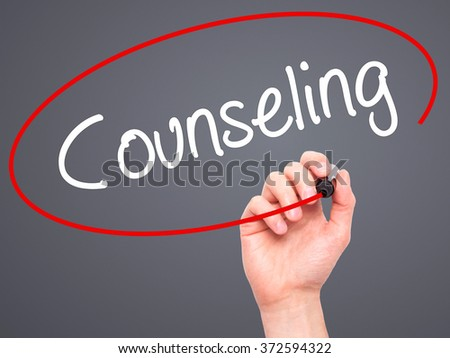 Man Hand writing Counseling with black marker on visual screen. Isolated on background. Business, technology, internet concept. Stock Photo - stock photo