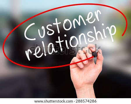 Man Hand writing Customer relationship with black marker on visual screen. Isolated on office. Business, technology, internet concept. Stock Image - stock photo
