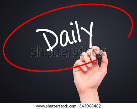Man Hand writing Daily with black marker on visual screen. Isolated on black. Business, technology, internet concept. Stock Photo - stock photo
