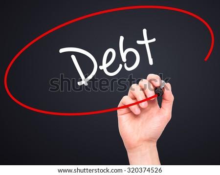 Man Hand writing Debt with black marker on visual screen. Isolated on black. Business, technology, internet concept.
