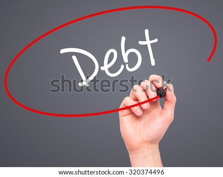 Man Hand writing Debt with black marker on visual screen. Isolated on grey. Business, technology, internet concept.