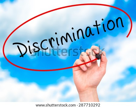 Man Hand writing Discrimination with black marker on visual screen. Isolated on sky. Business, technology, internet concept. Stock Image - stock photo