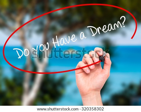 Man Hand writing Do you Have a Dream? with black marker on visual screen. Isolated on nature. Business, technology, internet concept. - stock photo