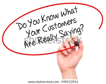 Man Hand writing Do You Know What Your Customers Are Really Saying? with black marker on visual screen. Isolated on background. Business, technology, internet concept. Stock Photo - stock photo