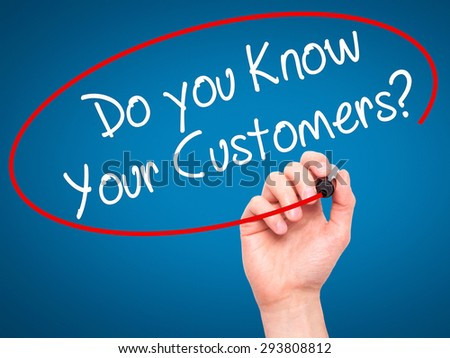 Man Hand writing Do you Know your Customers? with black marker on visual screen. Isolated on blue. Business, technology, internet concept. Stock Photo - stock photo