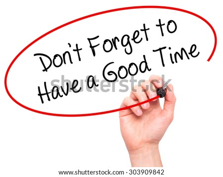 Man Hand writing Don't Forget to Have a Good Time with black marker on visual screen. Isolated on white. Business, technology, internet concept. Stock Photo - stock photo