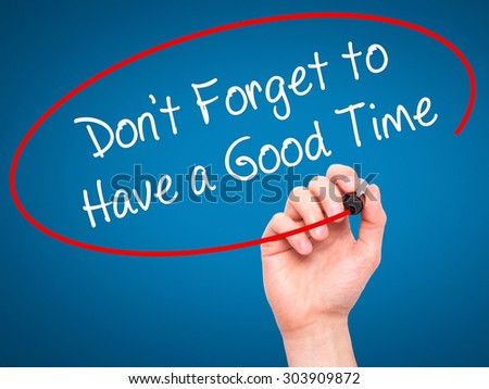 Man Hand writing Don't Forget to Have a Good Time with black marker on visual screen. Isolated on blue. Business, technology, internet concept. Stock Photo - stock photo