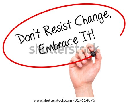 Man Hand writing Don't Resist Change, Embrace It! with black marker on visual screen. Isolated on white. Business, technology, internet concept. - stock photo