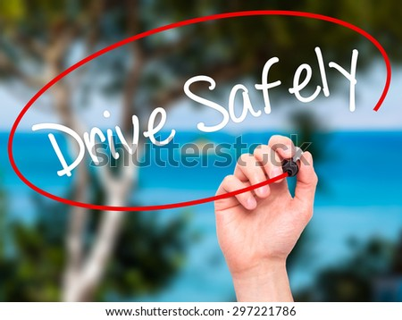 Man Hand writing  Drive Safely with black marker on visual screen. Isolated on nature. Business, technology, internet concept. Stock Photo - stock photo