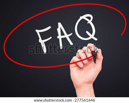 Man Hand writing FAQ - Frequently Asked Questions with marker on transparent wipe board. Isolated on black. Business, internet, technology concept.  Stock Photo - stock photo