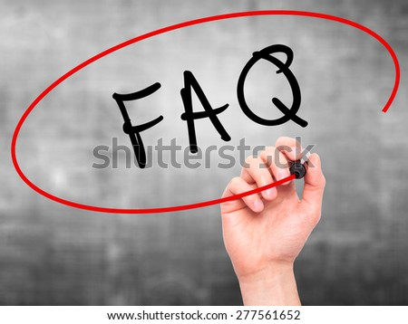 Man Hand writing FAQ - Frequently Asked Questions with marker on transparent wipe board. Isolated on grey. Business, internet, technology concept.  Stock Photo