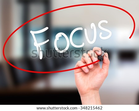 Man Hand writing Focus with black marker on visual screen. Isolated on background. Business, technology, internet concept. Stock Photo - stock photo