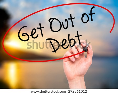 Man Hand writing Get Out of Debt with black marker on visual screen. Isolated on nature. Business, technology, internet concept. Stock Image - stock photo