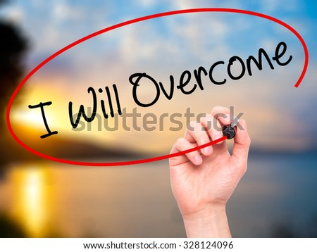 Man Hand writing I Will Overcome with black marker on visual screen. Isolated on nature. Business, technology, internet concept. Stock Photo - stock photo