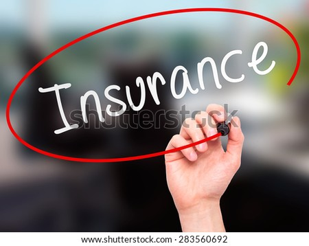 Man Hand writing Insurance with marker on transparent wipe board. Isolated on office. Business, internet, technology concept. Stock Photo - stock photo