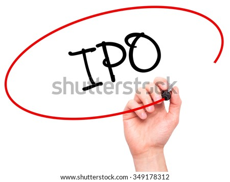 Man Hand writing IPO (Initial Public Offering)   with black marker on visual screen. Isolated on background. Business, technology, internet concept. Stock Photo
