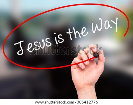 Man Hand writing Jesus is the Way with black marker on visual screen. Isolated on office. Business, technology, internet concept. Stock Photo - stock photo
